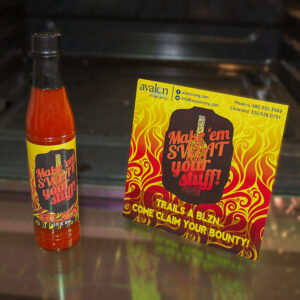 Customized bottle of hot sauce and promotional postcard
