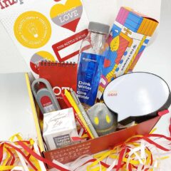 The Innovate, Inspire, Ignite campaign box open, with the contents of promotional items displayed inside.