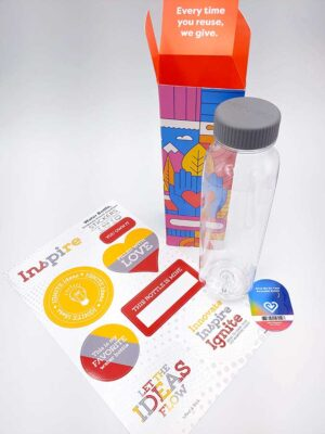A Fill It Forward water bottle, box and sticker, with a sheet of Innovate, Inspire, Ignite stickers next to it..