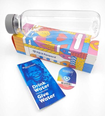 A Fill It Forward water bottle, box, pamphlet and sticker.