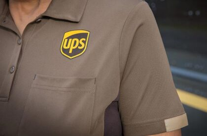 Closeup of the UPS logo embroidered on a uniform shirt.
